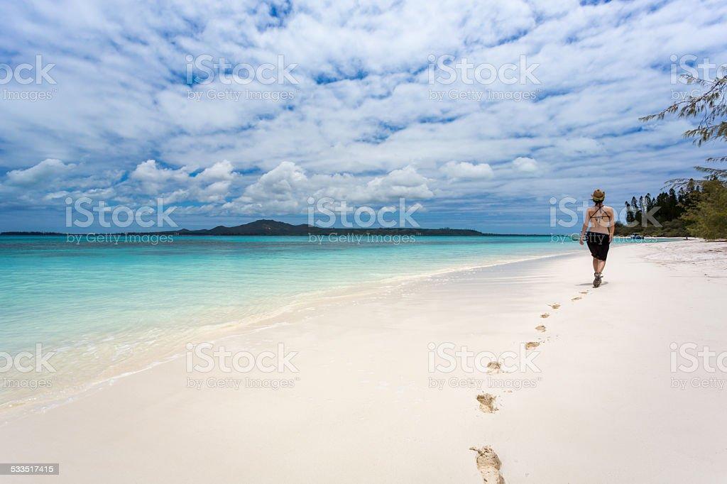 Woman Walking on Desert White Sand Tropical Beach stock photo