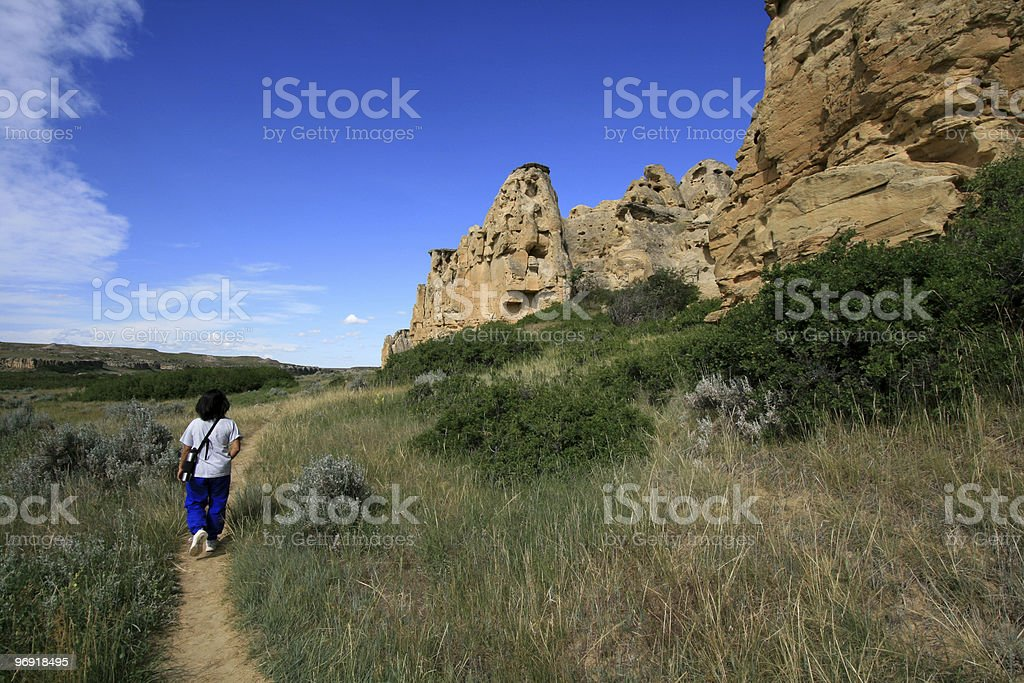 Woman Walking on Hoodoo Trail royalty-free stock photo