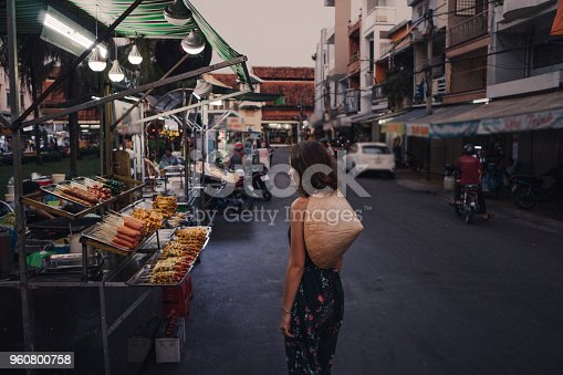 istock Woman walking on night market in Vietnam 960800758
