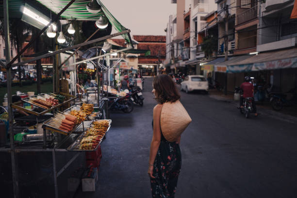 Woman walking on night market in Vietnam Young Caucasian woman  walking on night market in Vietnam vietnamese culture stock pictures, royalty-free photos & images