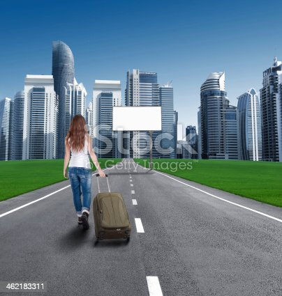 istock woman walking on road to city, in front empty Bill 462183311