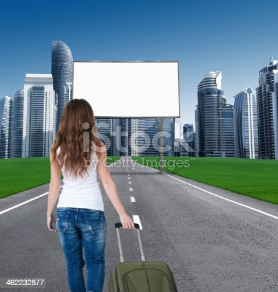 istock woman walking on road to city, in front empty Bill 462232877