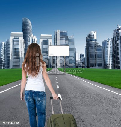 istock woman walking on road to city, in front empty Bill 462236145