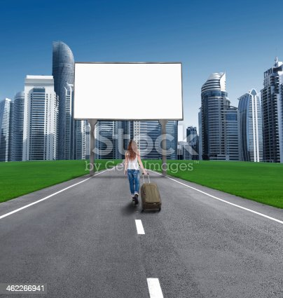 istock woman walking on road to city, in front empty Bill 462266941