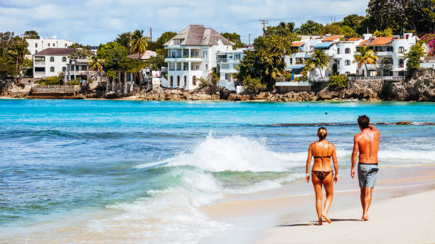 Woman walking on sandy beach - Barbados stock photo