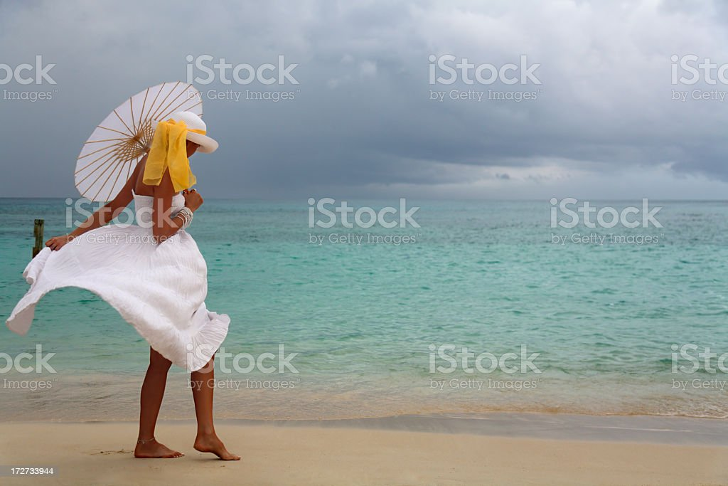 woman walking on stormy day royalty-free stock photo