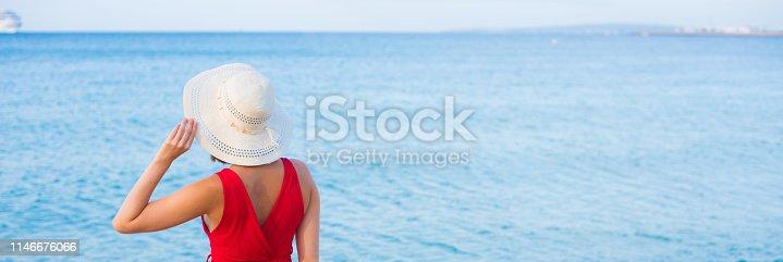 istock Woman walking on the beach 1146676066