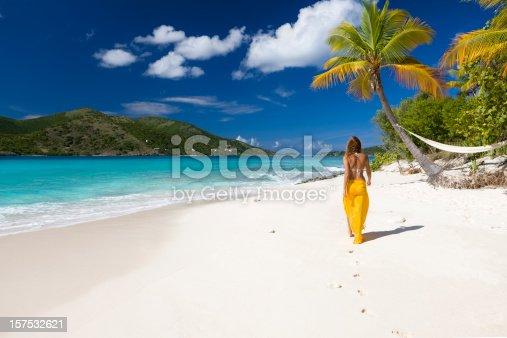 woman walking along the beach in the Caribbean paradise