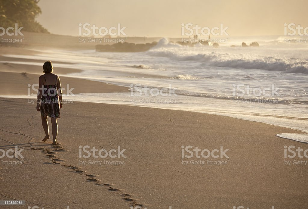 Woman Walking on the Beach royalty-free stock photo