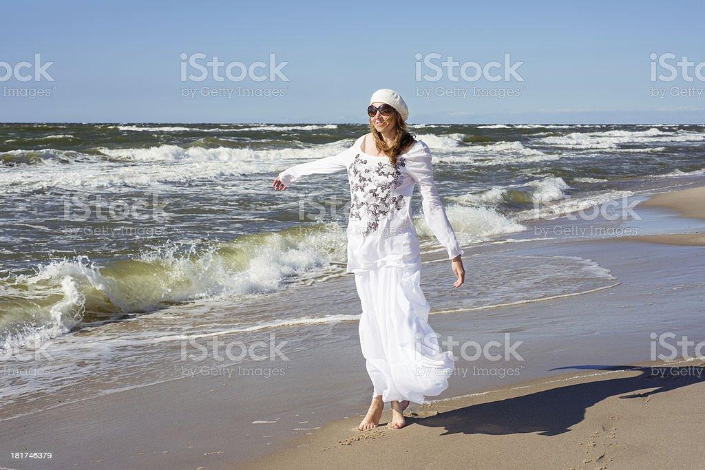 Woman walking on the sea royalty-free stock photo