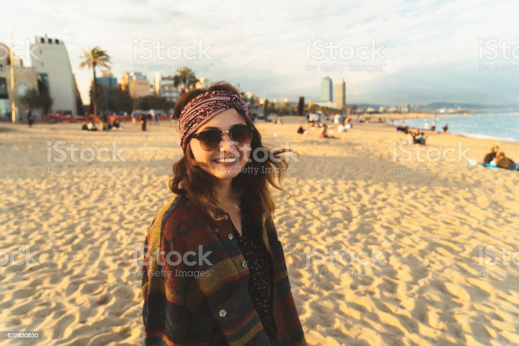 Woman walking on the seaside of Barcelona stock photo