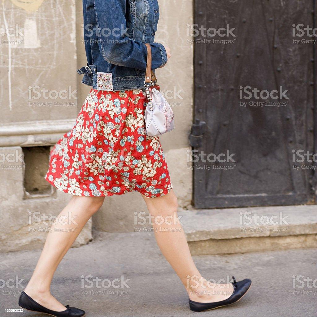 woman walking on the street stock photo
