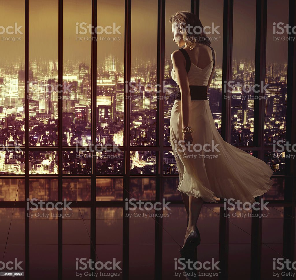 Woman walking on the top of  skyscraper stock photo