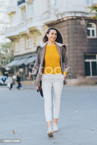 Beautiful Woman walking on the street