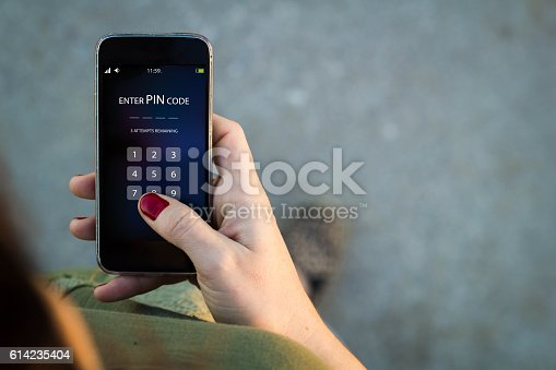 istock Woman walking smartphone interface pin code 614235404