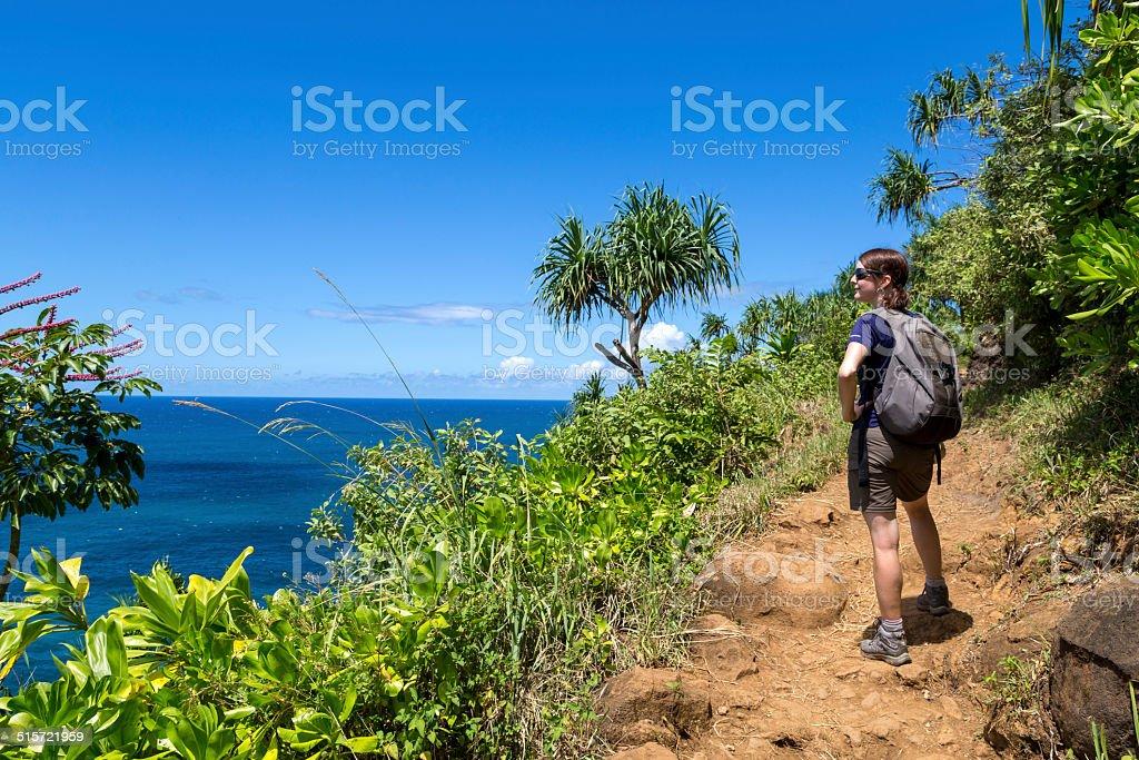 Woman Walking the Kalalau Trail, Napali Coast State Park, Kauai stock photo