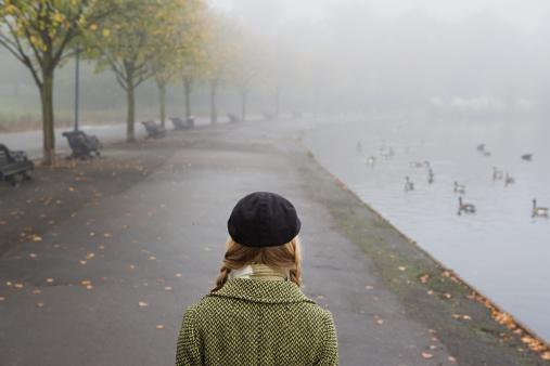 Woman walking through park
