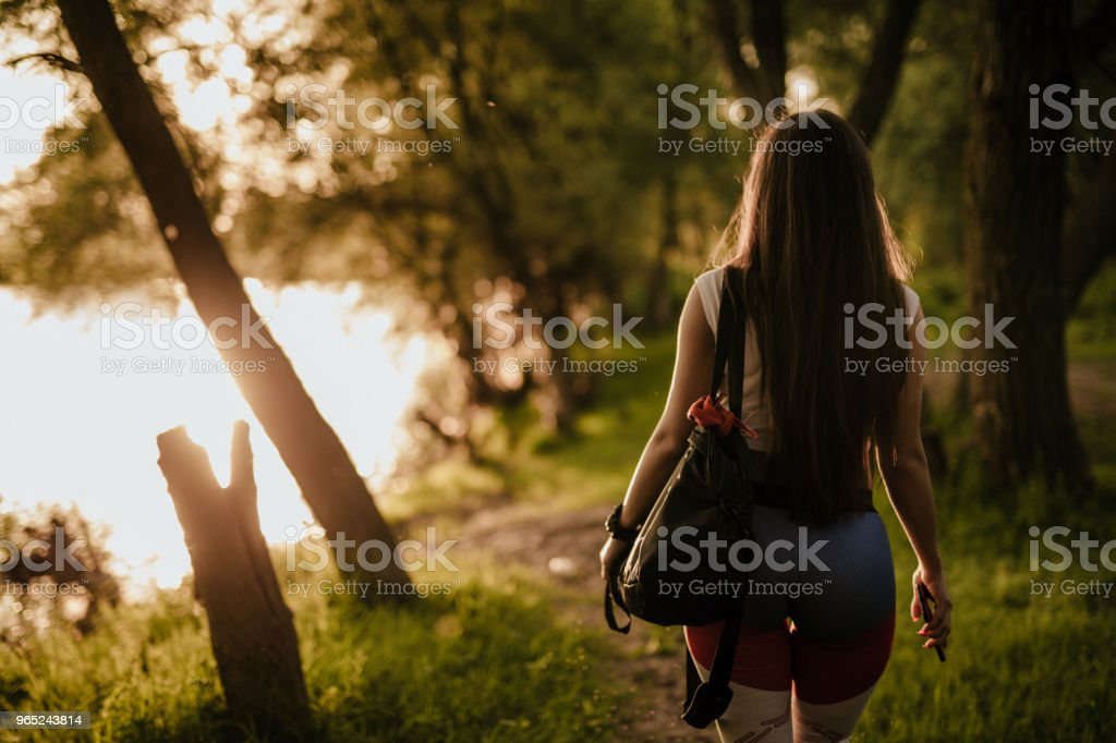 Woman walking through the local park royalty-free stock photo
