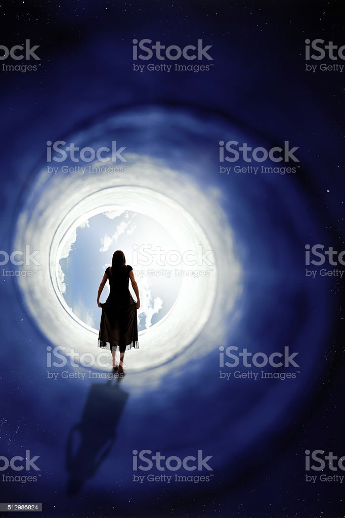 Woman Walking To Another Dimension stock photo