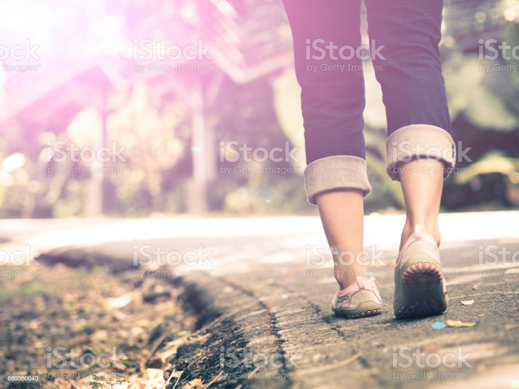 woman walking towards on the road side. royalty-free stock photo
