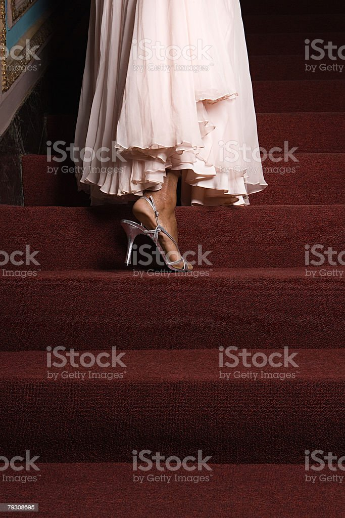 A woman walking up a set of stairs royalty-free 스톡 사진