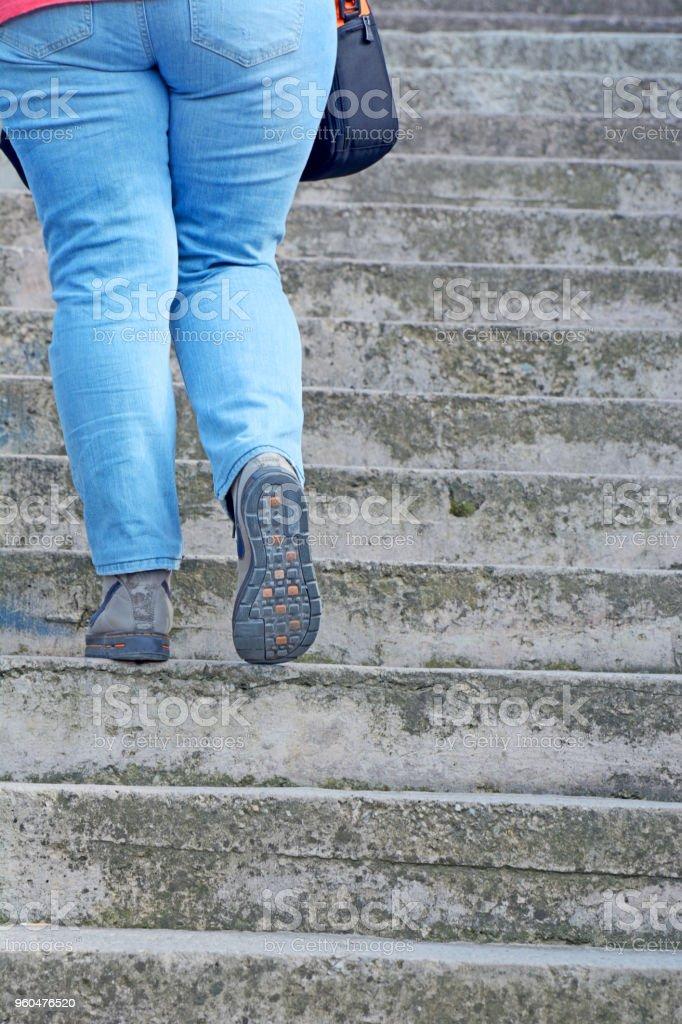 woman walking up stock photo
