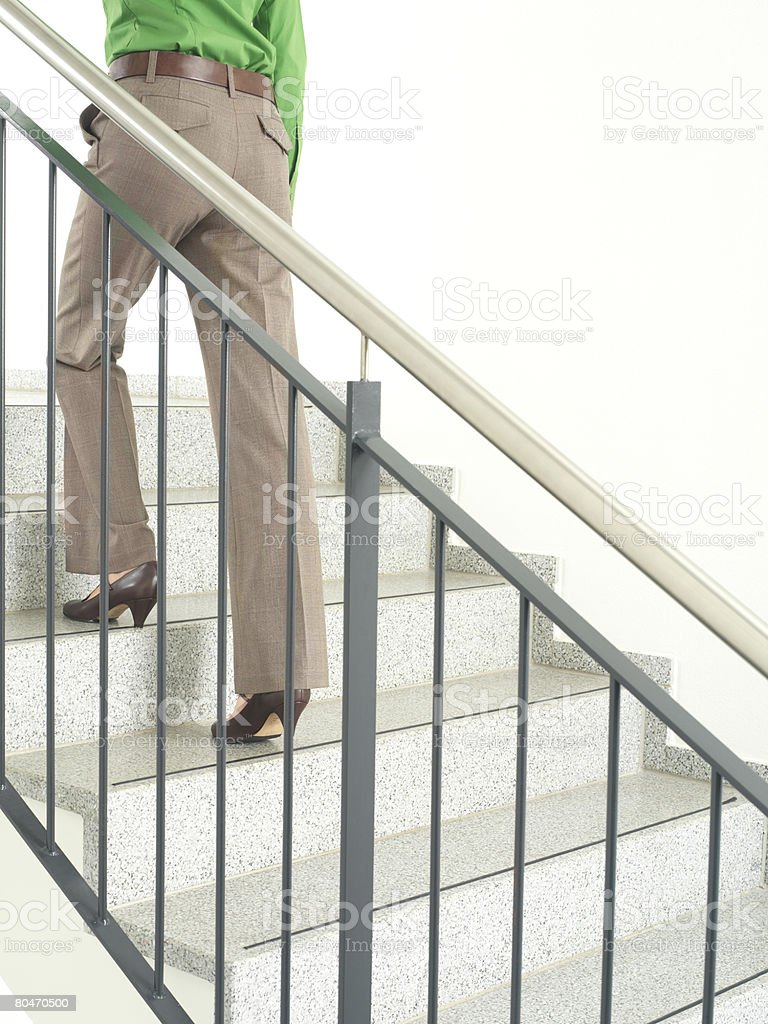 A woman walking up stairs 免版稅 stock photo