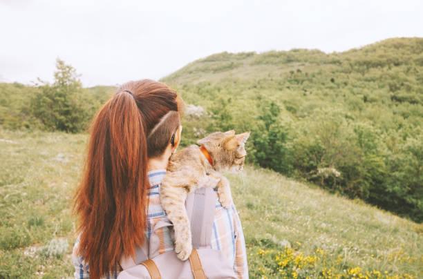 Woman walking with a cat on nature in summer picture id1173303829?b=1&k=6&m=1173303829&s=612x612&w=0&h=rqsjzmmieqjk 82obgpbuoyc7bxj  o moiza fw7nk=