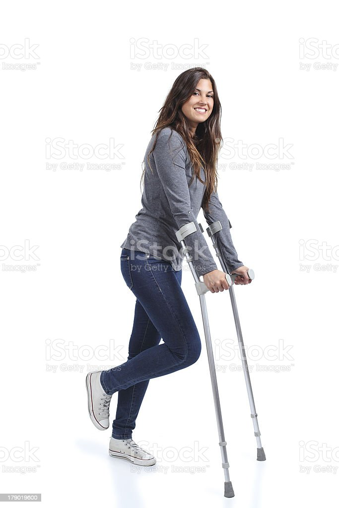 Woman walking with crutches royalty-free stock photo