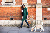 istock Woman walking with dog in early Sunday morning in London 508749850