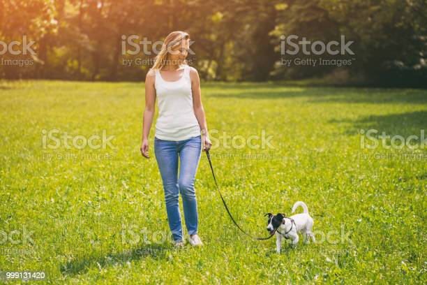 Woman walking with her dog jack russell terrier picture id999131420?b=1&k=6&m=999131420&s=612x612&h=1ofwjrmv2l2bcz5deq7kcwf4stsfnxwuuumbkbiqu1s=