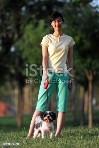 istock Woman Walking With Her Dog - XLarge 182818078