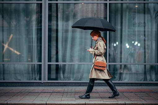 A Woman Walking with Umbrella