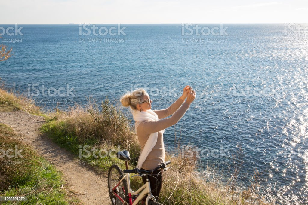 She looks off to distant scene
