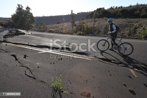 The road is cracked and broken from an earthquake, Hawaii Volcanoes National Park