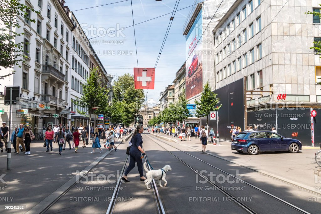 Woman walks dog in city centre of Zurich stock photo