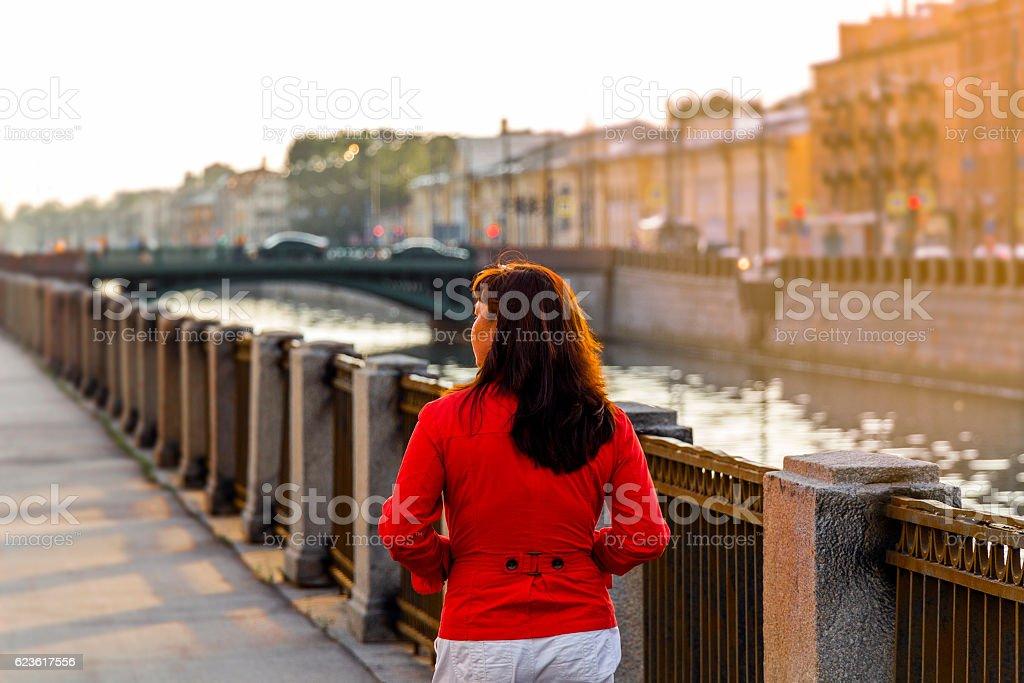 Woman walks through the old town stock photo