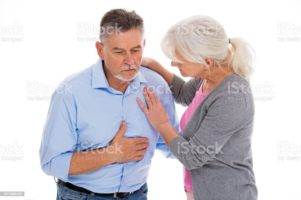 Woman want to help man with chest pain stock photo