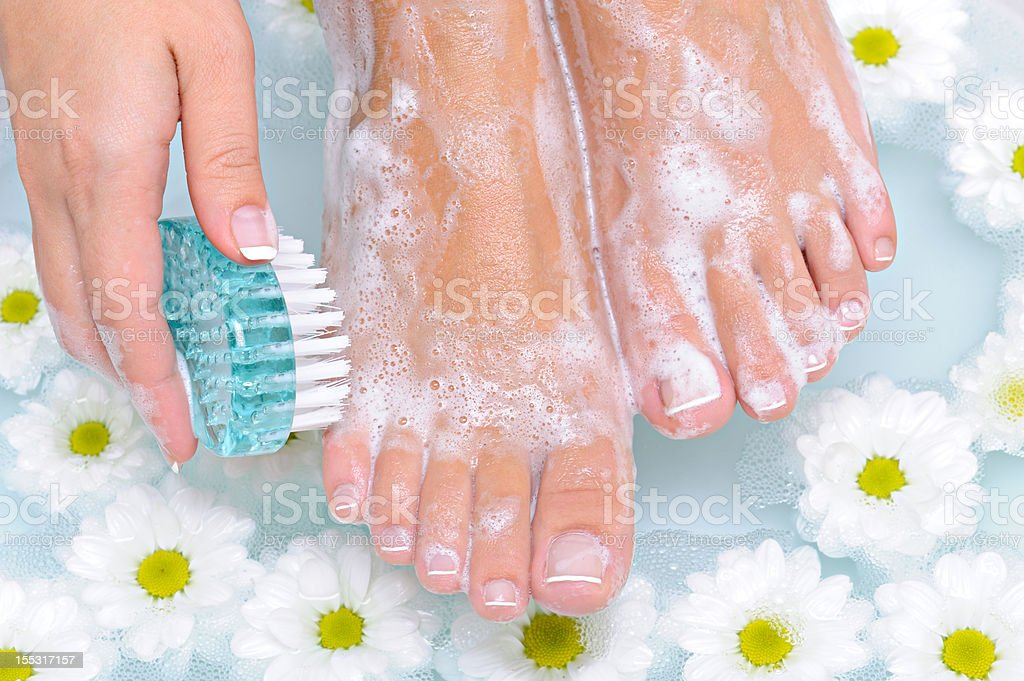 Woman washes and cleans her foot stock photo