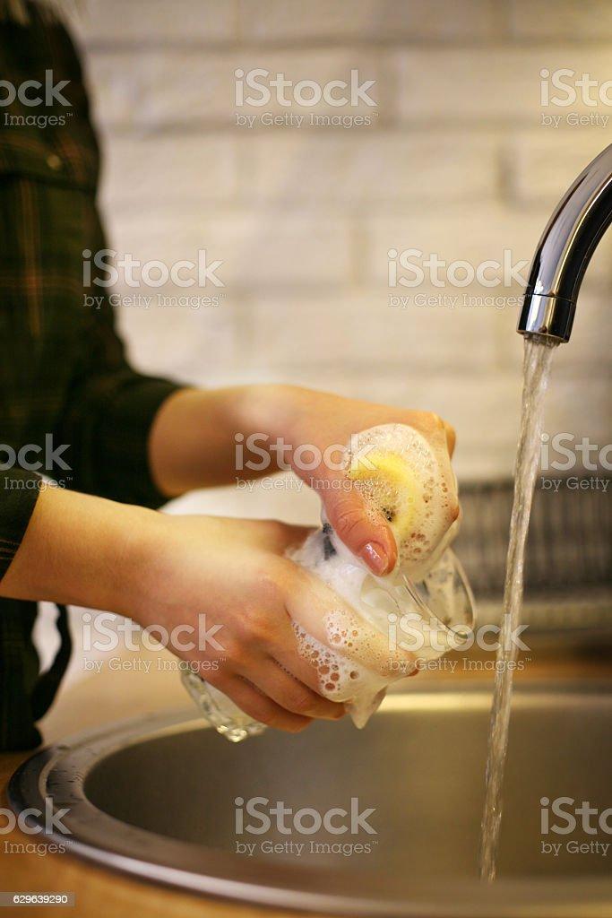 Woman washing dishes. stock photo