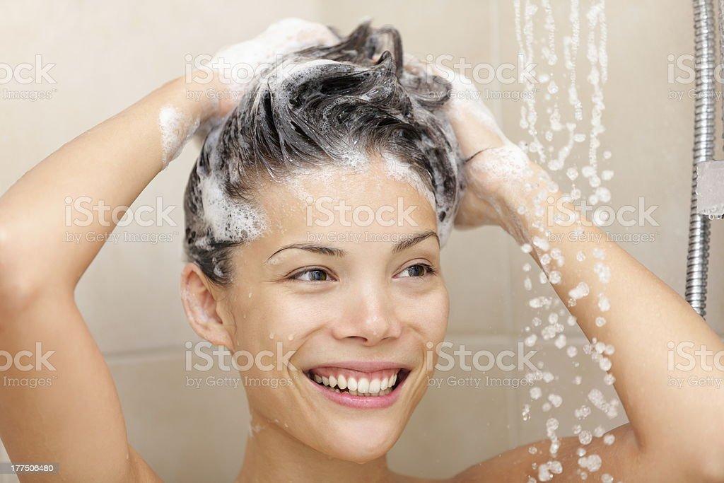Woman washing hair stock photo