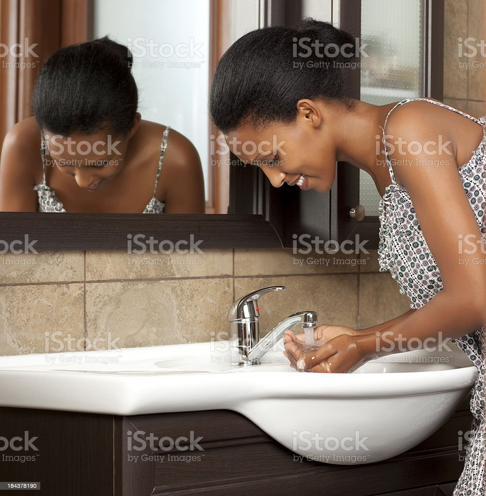 Woman washing hands in bathroom royalty-free stock photo