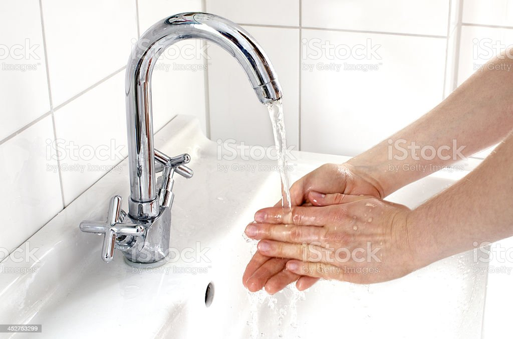 Woman washing hands royalty-free stock photo
