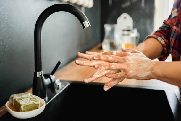 woman washing hands with soap - saponetta foto e immagini stock