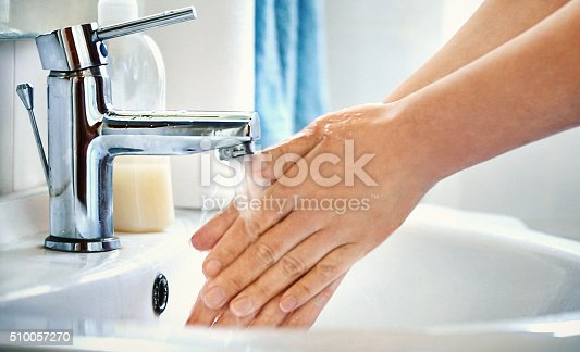 477282566 istock photo Woman washing her hands. 510057270