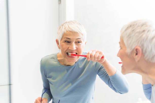 Woman washing her teeth stock photo
