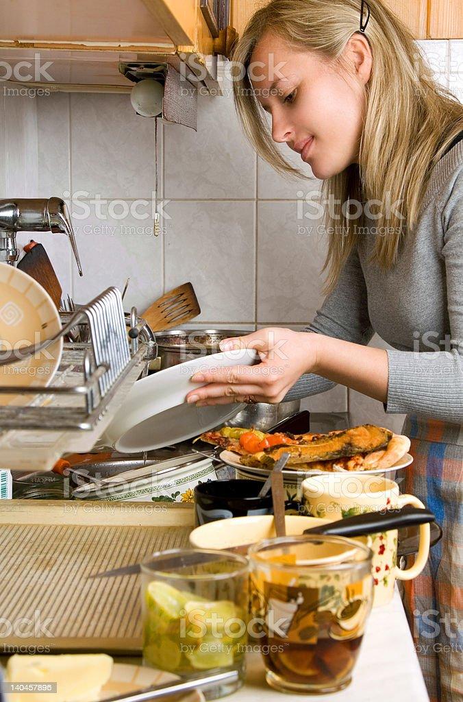 woman washing plates royalty-free stock photo