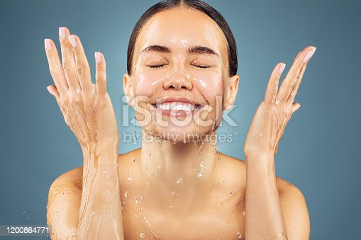 Woman washing up her face