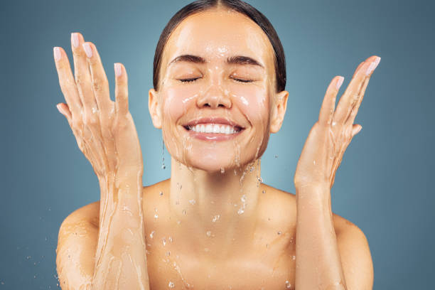 Woman washing up her face stock photo
