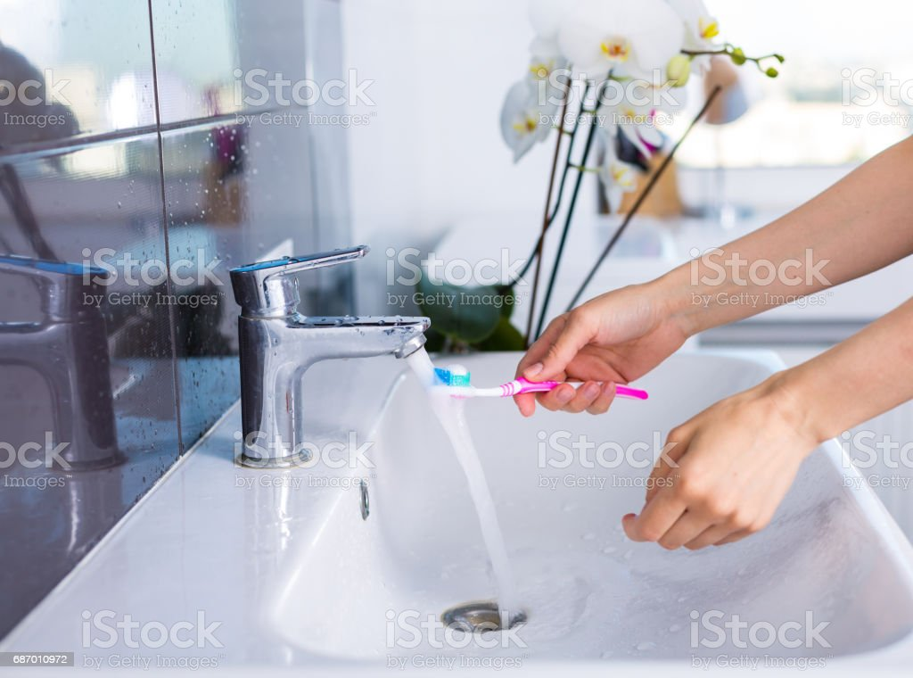 Woman washing up in the morning stock photo